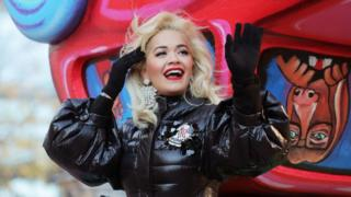 Singer Rita Ora waves to the crowd during the Macy's Thanksgiving Day Parade in Manhattan, New York, 22 November 2018