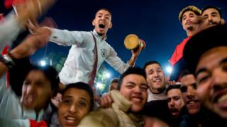 "Moroccans celebrate November 11, 2017 in Marrakech following Morocco""' victory over Ivory Coast in their FIFA 2018 World Cup Africa Qualifier to participate the FIFA 2018 World Cup."