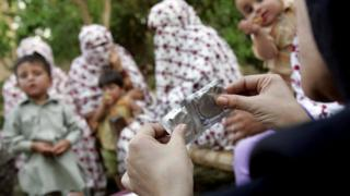 Condoms are shown to a group of women during a safe sex education class in Sawabi in the conservative Muslim Pashtun belt of western Pakistan (file photo)