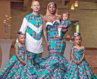 Justin and Aminat McClure pose in clothes inspired by West Africa with their twin daughters and son