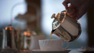 Waitress pouring tea at Bettys Tea Room, Harlow Carr in Harrogate