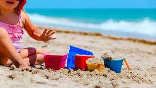 Child playing on beach