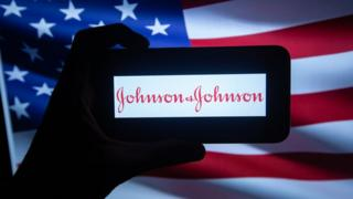 Johnson & Johnson logo in front of US flag