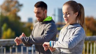 Couple wearing fitness trackers