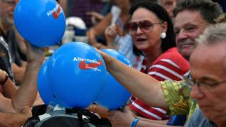 People with balloons attend an election rally of the far-right Alternative to Germany (AfD) party at Koenigs Wusterhausen