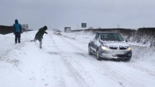 Car and people in snow