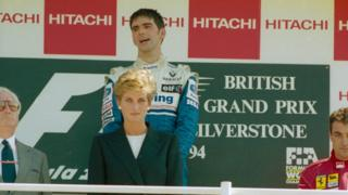 Williams-Renault driver Damon Hill on the podium with Princess Diana after he won the 1994 Grand Prix.