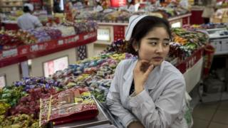 Female worker in Chinese grocery shop