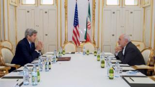U.S. Secretary of State John Kerry (L) meets with Iranian Foreign Minister Javad Zarif at a hotel in Vienna, Austria June 30, 2015.