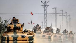 Turkish Army tanks drive to the Syria-Turkey border. Photo: 30 August 2016
