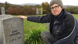 Robert Ross with headstone