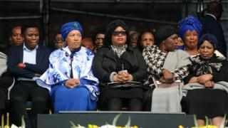 Winnie Madikizela-Mandela's daughters Zanani (2-L) and Zindzi (3-L) with family members attend the memorial service of Winnie Madikizela-Mandela at the Orlando stadium in Soweto, South Africa.