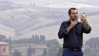 Interior Minister Matteo Salvini poses for a selfie during a visit to an estate which was permanently confiscated in 2007 from the mafia