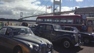 Some of the vintage cars and buses which lined up ahead of a procession across the bridge