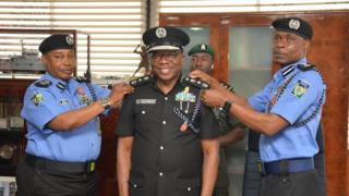 Three Nigerian police officers tanda as one dey collect new rank of DIG for Force Headquarters, Abuja