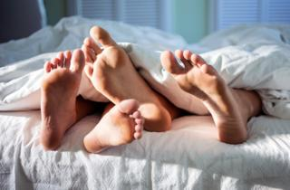 Detail of feet in a bed