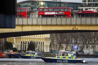 Boats from the Metropolitan Police Marine Policing Unit patrol near the scene