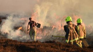 Firefighters tackle a blaze on moorland above Marsden