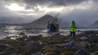 Isle of Skye Portree Coastguard Rescue Officer with Local Fishing vessel