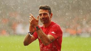 Francis Benali applauded by crowd after run