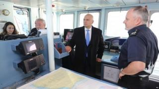 Sajid Javid speaks to the crew of HMC Searcher in the Dover Strait