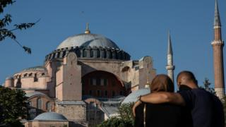 A couple stand in front of Istanbul's famous Hagia Sophia, 22 July 2020