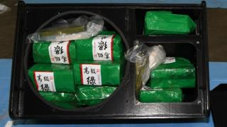 The vacuum-packed packages of the drugs featuring Chinese writing packed inside the stereo speakers
