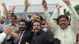 PML-N supporters celebrate party loyalist Abbasi's election as premier last August