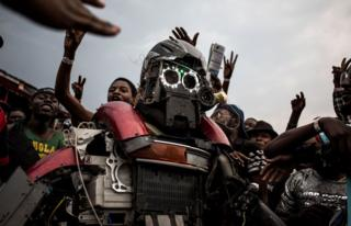 A Congolese festival-goer dressed as a robot.