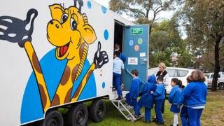 Children visit a Healthy Harold van in Australia