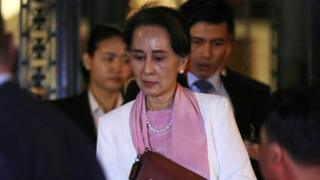 Myanmar's leader Aung San Suu Kyi leaves the International Court of Justice (ICJ), the top United Nations court, after court hearings in The Hague, Netherlands, 12 December, 2019