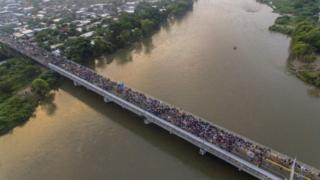 An aerial view of the migrant caravan on the Guatemala-Mexico border bridge