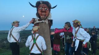Wessex Morris Men welcome the May Day sunrise by the Cerne Abbas giant, Dorset