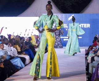 A model in flares on the catwalk in Bamako, Mali - Saturday 20 October 2018