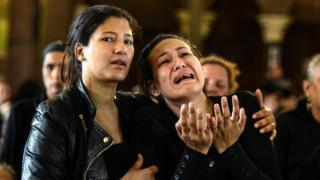 Female mourners react during the funeral of Copts who died a day earlier in the bomb explosion in Alexandria, Monastery of Saint Mina outside of Alexandria, 10 April