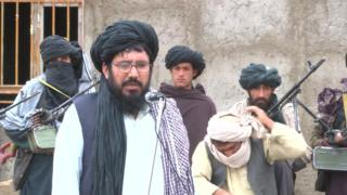 Mullah Rasool addresses Taliban fighters at the meeting in Farah