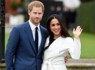 Prince Harry pose with Meghan Markle during a photocall after announcing their engagement in the Sunken Garden in Kensington Palace in London, Britain, 27 November.