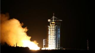 Rocket containing the world's first quantum satellite is launched in Jiuquan, Gansu Province, China, 16 August 2016.