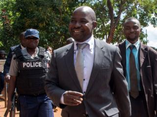 Zimbabwe's chief prosecutor Johannes Tomana (C) arrives at the Harare Magistrates court on February 2, 2016