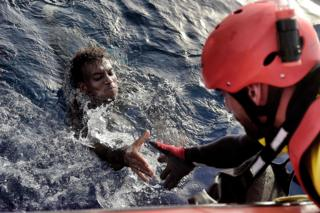 A migrant is rescued from the Mediterranean sea by a member of Proactiva Open Arms NGO some 20 nautical miles north of Libya, 3 October 2016.
