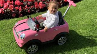 Willow in a Mini pedal car