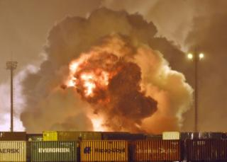 Fire rises from chemical containers from logistic company Localfrio in Guaruja, Brazil, January 14, 2016