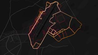 "Red ""heat lines"" are arrayed neatly in the pattern of roads and streets on a dark black map"