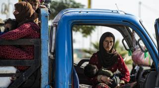Families flee northern Syria