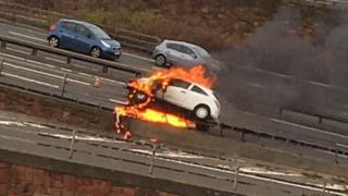 Car on fire on M8