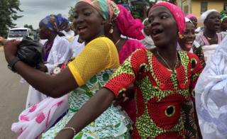 """Muslim women dance as they parade through their small town, Assin Foso, in Ghana""""s Central Region to celebrate Eid al-Fitr July 6, 2016. Picture taken July 6"""