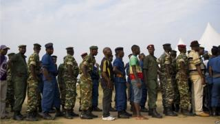 Civilians, army soldiers and police queue to vote in the opposition stronghold of Musaga in Bujumbura on June 29, 2015