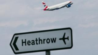 A Heathrow sign and an aeroplane