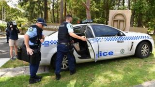 Police officers outside the Scientology complex in Sydney's north