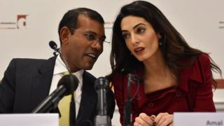 British lawyer Amal Clooney (R) listens as former Maldives president Mohamed Nasheed speaks during a press conference in London, on January 25, 2016